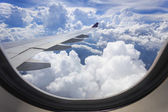 Cloud and wing of airplane — Stock Photo