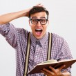 Nerdy man is in panic because he doesn't have too much time for learning — Stock Photo #59962771