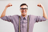 Nerdy man showing how strong he is — Stock Photo