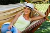 Woman is lying on hammock and enjoy in her free time — Foto de Stock