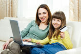 Mother and daughter shopping online at home — Photo