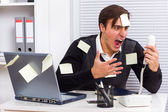 Businessman shouting on telephone at his office — Stock Photo