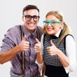 Nerdy couple showing thumbs up — Stockfoto #60616393