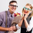 Portrait of happy nerdy couple — Stock Photo #60616419