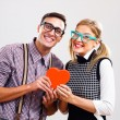 Portrait of happy nerdy couple — Stock Photo #60616557