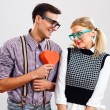 Nerdy man is about to give a red heart to his nerdy lady — Stockfoto #60616571
