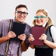 Nerdy man and woman with books — Stock Photo #60616577