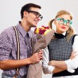 Nerdy man is giving a bouquet of flowers to his girlfriend — Stock Photo #60616583