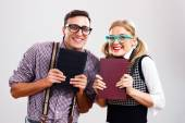Nerdy man and woman with books — Stockfoto