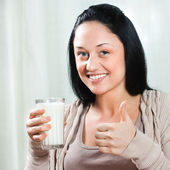 Woman holding glass of milk — Stock Photo