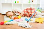 Housewife is very tired of housework and she is napping — Stock Photo
