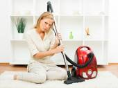 Beautiful housewife with vacuum cleaner — Stok fotoğraf
