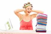 Housewife is in panic because she has a lot of laundry — Stock Photo