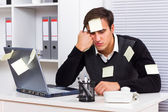 Businessman with too much work to do — Stockfoto