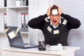 Businessman with too much work to do — Stock Photo