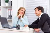 Woman is flirting with her boss at work — Stock Photo