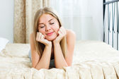 Woman lying on her bed and dreaming about something — Stock Photo