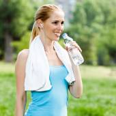 Woman with water at park — Stock Photo