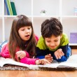 Little girl and little boy  take a break from homework — Stock Photo #65772825