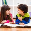 Little girl and little boy  take a break from homework — Stock Photo #65772841