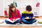 Girl and little boy are doing their homework — Stock Photo