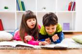 Little girl and little boy  take a break from homework — Stock Photo