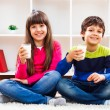 Cute little girl and little boy are holding glass of milk — Stock Photo #66821113