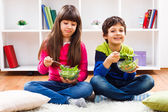 Little girl and little boy have to eat vegetables — Stock Photo