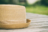 Photo of hat on wooden table — Stock Photo