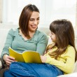 Mother helps daughter with her homework — Stock Photo #69537217