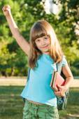 Portrait of cute little schoolgirl in park — Foto Stock