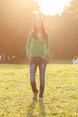 Woman enjoys walking in the park — Stock Photo