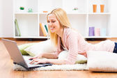 Woman using laptop at her home — Stock Photo