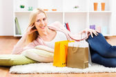 Woman resting at her home after shopping — Stock Photo