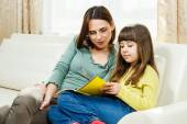 Mother and daughter on sofa — Stock Photo