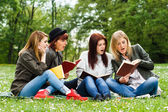 Girls are surprised because of something they had read in a book — Stock Photo