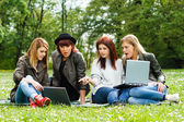Young girls are very surprised looking at laptop — Stock Photo