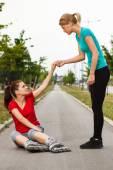 Girl in roller skates fell down — Stock Photo