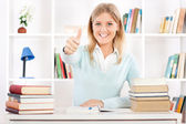 Beautiful young student showing thumb up — Stock Photo