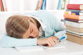 Young female student fell asleep after learning — Stock Photo