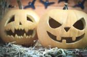 Two different Halloween pumpkins on autumn background — Stock Photo