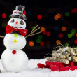 Snowman and sled on bokeh lights background — Stock Photo #59571665