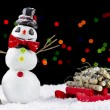 Snowman and sled on bokeh lights background — Stock Photo #59571691