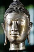 Bronze buddha head. close-up — Stock Photo
