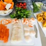 Salmon, fish fillet, scallops and scampi ready to prepare — Stock Photo #57575003