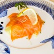 Smoked salmon nicely presented on a plate — Stock Photo #57575015