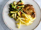 Grilled pork steak with french fries and mixed vegetables — Stock Photo