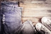 Jeans and sneakers on a wood background. — Foto Stock