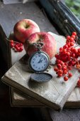 Clock, books and apple on the old window sill — Stockfoto
