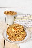 Karelian pies and a glass of milk — Stock Photo